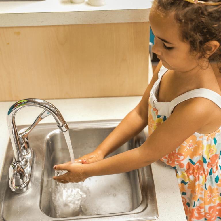 Health & Safety, girl washing hands at preschool