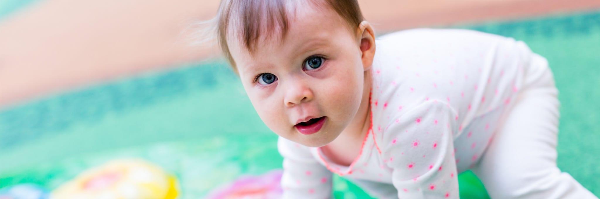 infant at preschool exploring their surroundings