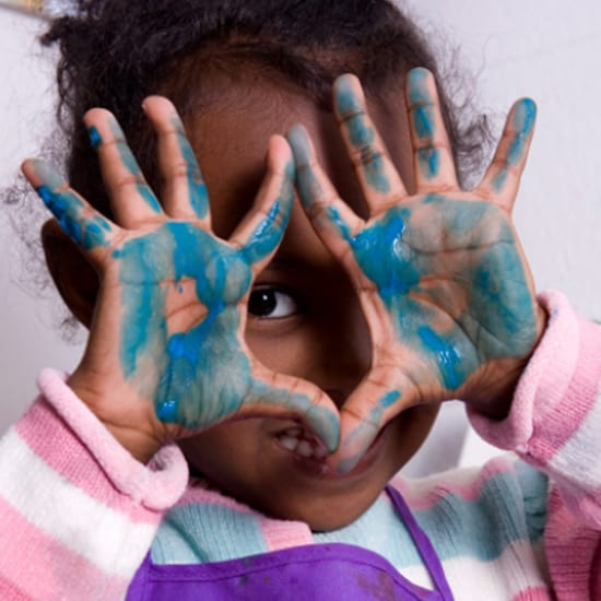 our curriculum preschool girl with painted hands