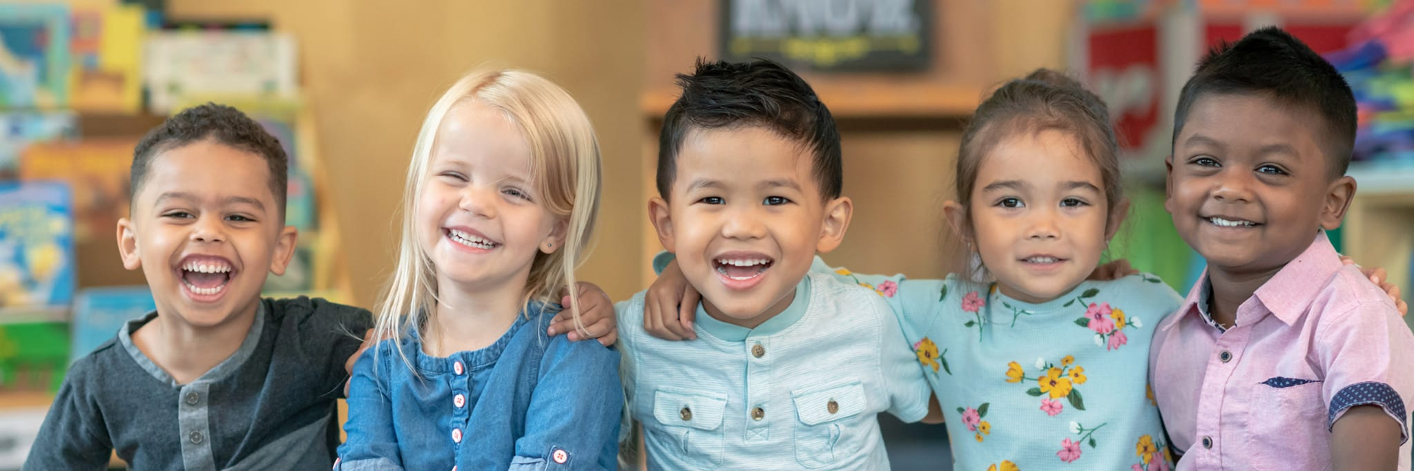 school acquisitions, preschoolers smiling side by side