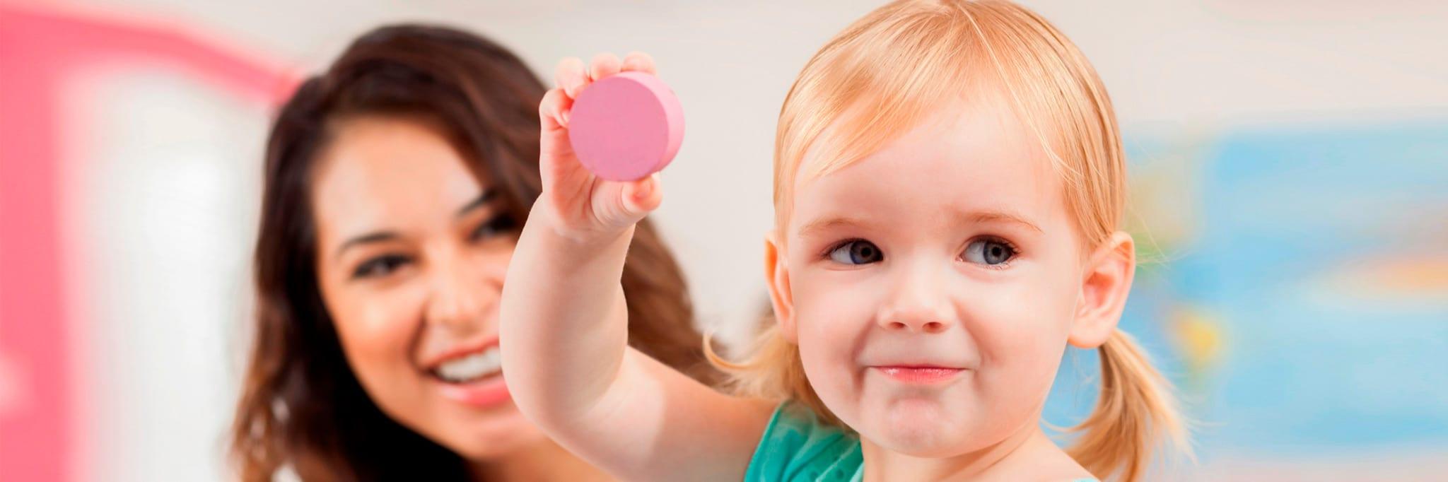 young preschooler girl showing her toy
