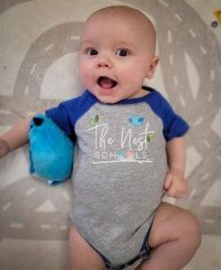 infant in nest t shirt