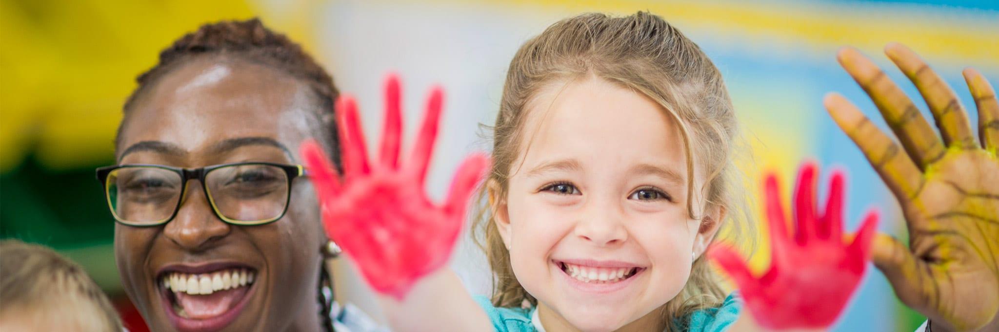 older preschoolers painted hands banner