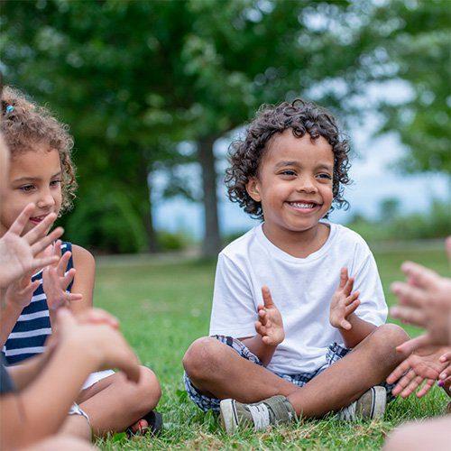 kindergarten kids playing in field